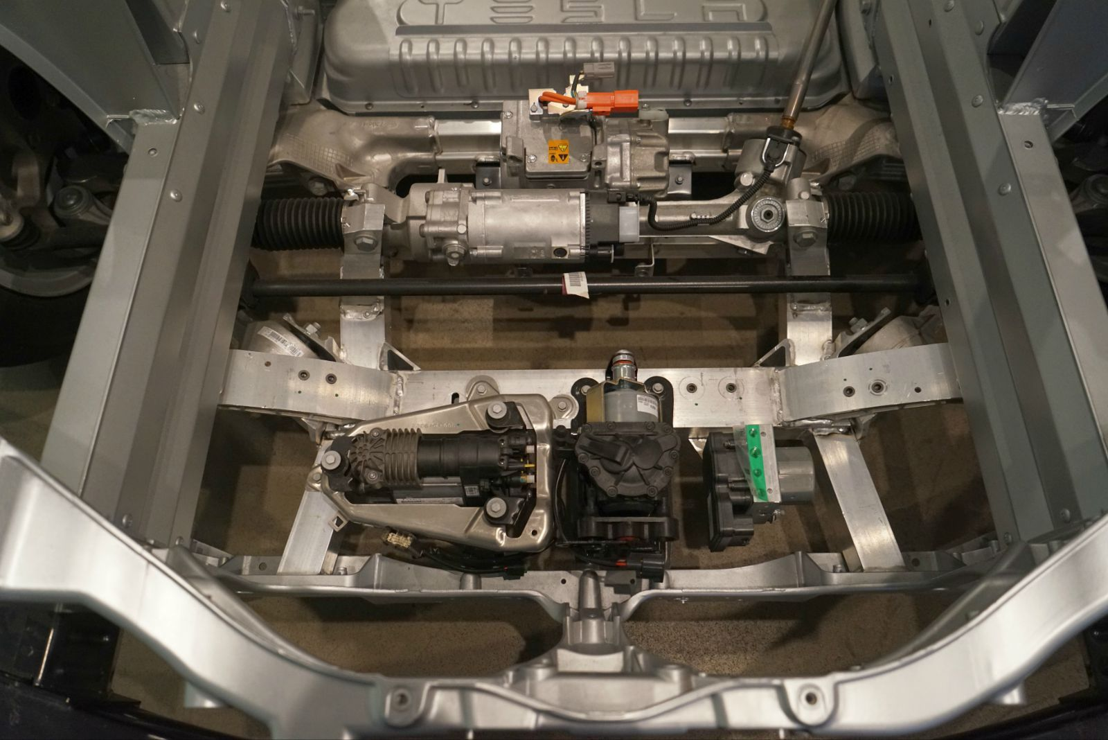 特斯拉汽车所用的交流感应电机的工作原理其实是