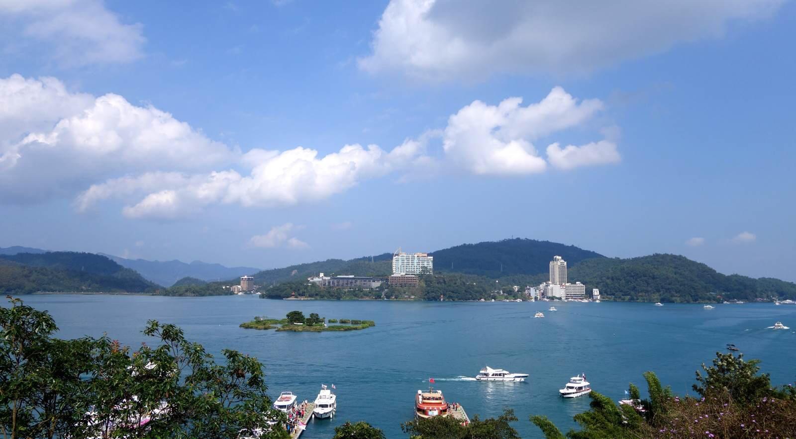 日月潭,这个打小就从小学课本上了解到的台湾风景名胜,故事大陆必去稿v从小小学生游客图片